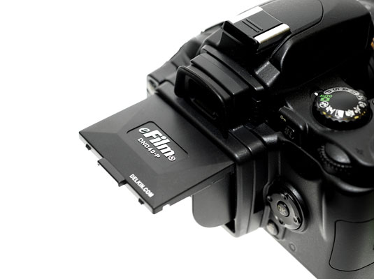 a digital camera with an LCD hood that reduces glare on the screen.